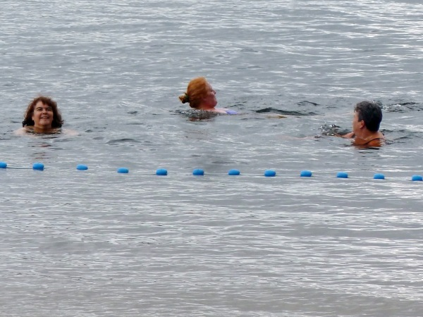 Three ladies swimming